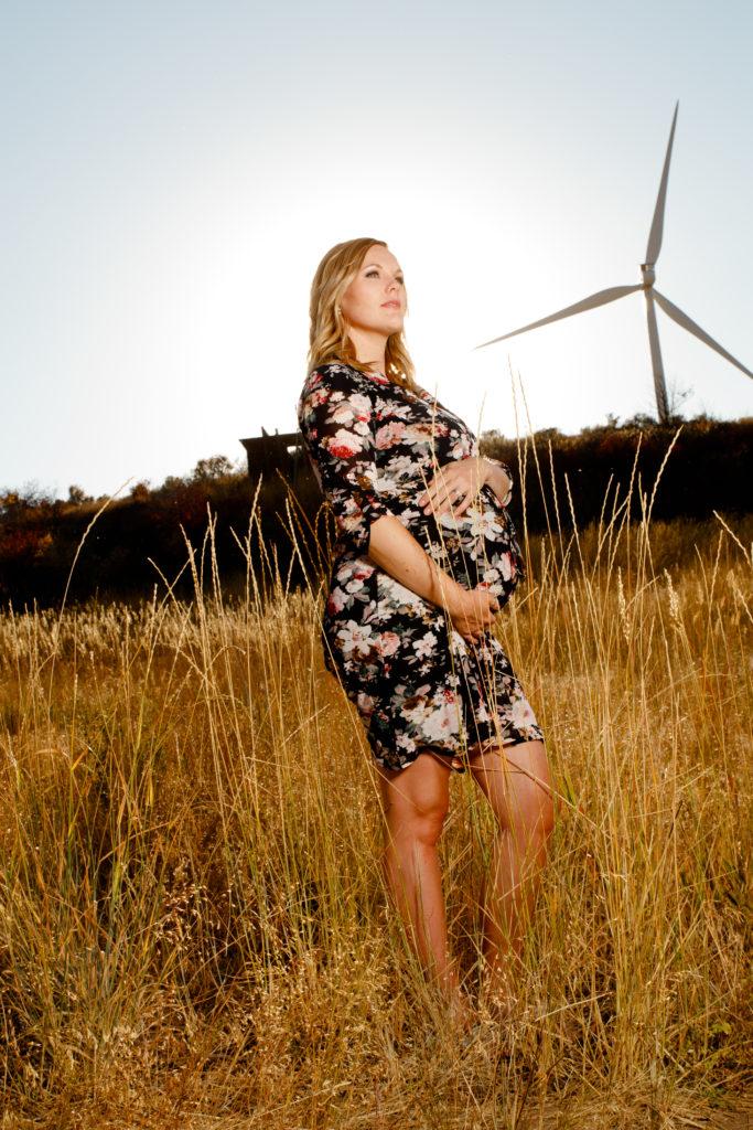 maternity photoshoot, floral dress, windmills